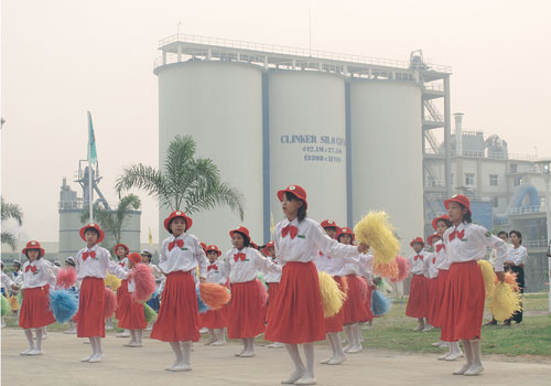 Girls dance at the opening of Max Myanmar's cement factory near Nay Pyi Taw. Photo: Sann Oo