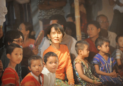 Daw Aung San Suu Kyi with children, some in traditiona Kayin dress, in Wa Thin Ka village in Kawhmu township on March 31, the day before she won a seat in parliament. Ko Taik / The Myanmar Times