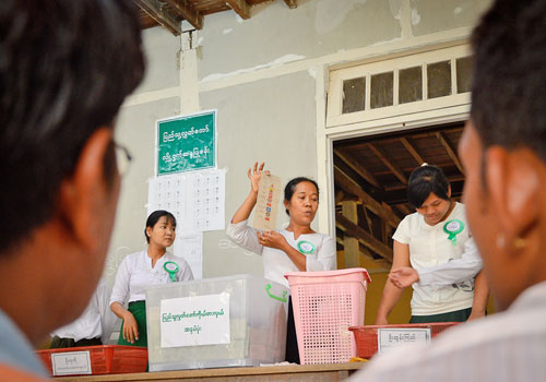 Election commission officials count votes in Maha Aung Myay on April 1. Si Thu Naing / The Myanmar Times