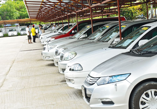 Cars sit at Sakura car showroom in Yangon recently. Boothee/ The Myanmar Times