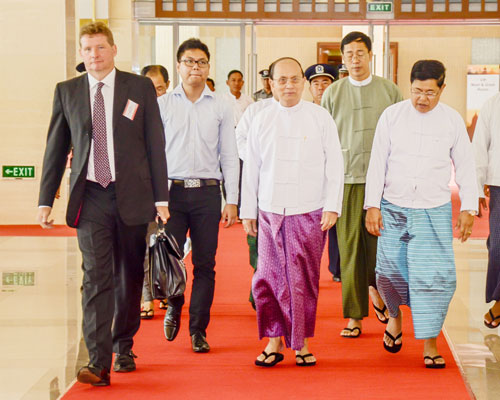 President U Thein Sein, Myanmar Investment Commission chairman U Soe Thein (front right) and Euromoney chief executive officer for Asia Tony Shale (front left) enter the Myanmar Global Investment Forum venue on September 12. Boothee / The Myanmar Times