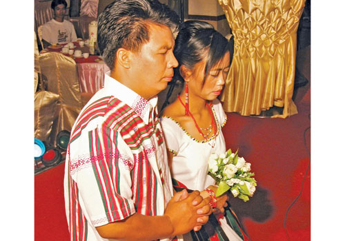 Chin couple receive blessings during their traditional wedding. Photo: The Myanmar Times
