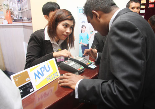 A customer uses a point of sale keypad during the Myanmar Payment Union launch in Yangon in mid-September.  Thiri Lu / The Myanmar Times