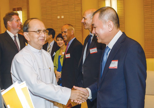 President U Thein Sein is greeted by attendees of the Myanmar Global Investment Forum in Nay Pyi Taw in mid-September.Bothee / The Myanmar Times