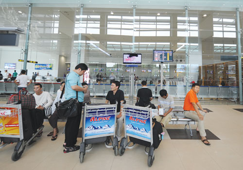 Passengers at Yangon International Airport. Ko Taik / The Myanmar Times