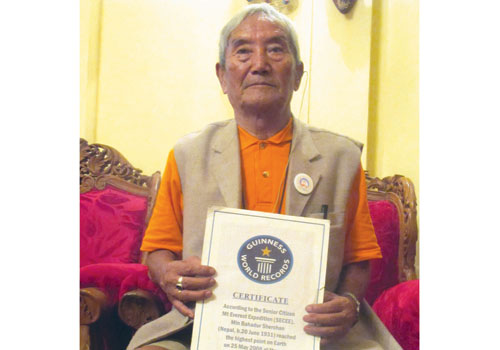 Min Bahadur Sherchan poses with his certificate from Guinness World Records, recognising him as the oldest person to climb Mount Everest. Pic: Supplied