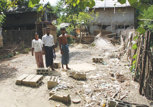 Residents of Ookyay village in Pyinmana township point to where their home stood before they were ordered to destroy it or face prison time. Soe Than Lynn / The Myanmar Times