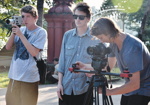 Ali Drummond, Toby Mills and James Holman (left to right) shoot scenes in Kandawgyi Park in Yangon on October 15 for their new documentary on the skateboarding scene in Myanmar. Nyein Maung/ The Myanmar Times
