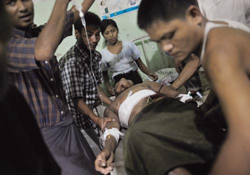 A man with a gunshot wound is treated at Kyauktaw Township Hospital in Rakhine State on Thursday, October 25, 2012. (Kaung Htet / The Myanmar Times)