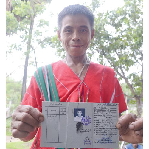 A Kayin man from northeast Bago Region holds a newly issued identity document, which allows him to travel legally around the country in May 2012. (Nan Tin Htwe / The Myanmar Times)