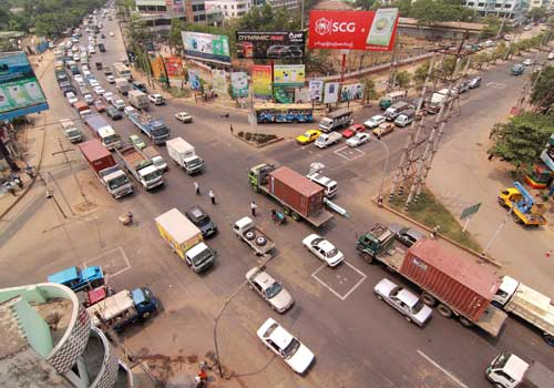 Vehicles pass through Bayintnaung Junction. (Boothee / The Myanmar Times / November 12, 2012)