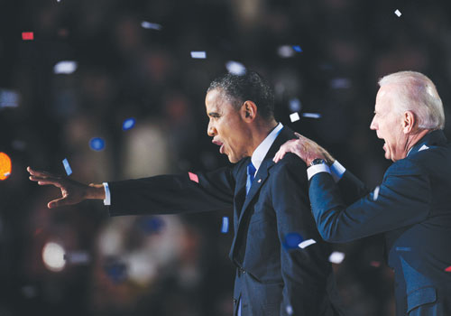 US President Barack Obama and Vice President Joe Biden celebrate on stage after Obama delivered his acceptance speech Wednesday, November 7, 2012 in Chicago. (AFP)