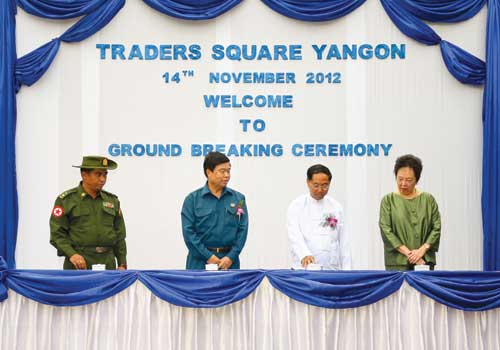 Yangon Region Chief Minister U Myint Swe (2nd R) and Ms Kay Kuok (far R) wait to start the drill to break ground on the Trader Square project in Yangon Wednesday, November 14, 2012. (Boothee / The Myanmar Times)