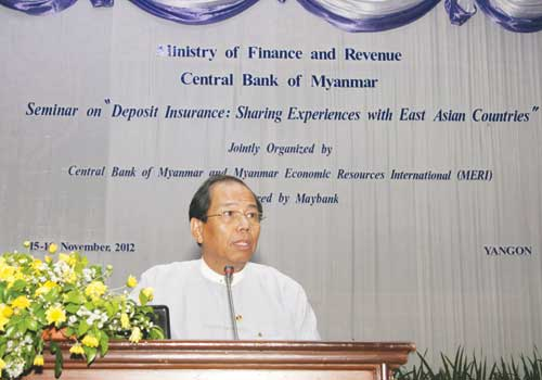 Central Bank of Myanmar deputy director general U Thein Zaw speaks at a seminar in Yangon Friday, November 16, 2012.  (Thiri Lu / The Myanmar Times)