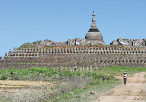 A man walks in front of a temple at Mrauk-Oo. Douglas Long / The Myanmar Times