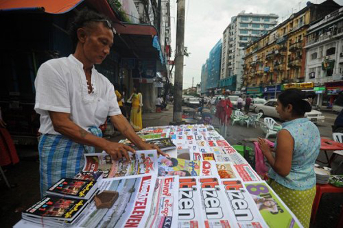A vendor sells news journals in downtown Yangon in December 2012. Denmark-based IMS says more training is needed to ensure that journalist can cultivate the country's new freer media environment. (AFP)