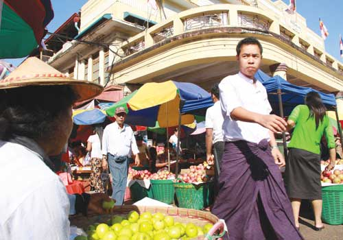 Shoppers and store owners at Theingyi Market in Latha township, Yangon December 2012. (Thiri Lu / The Myanmar Times)