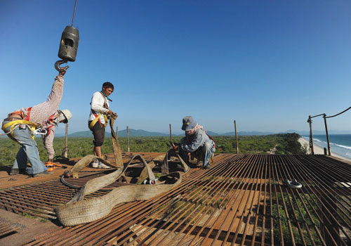 Labourers work on an elevated platform at a deep sea port project in Tanintharyi Region that is part of the Dawei Special Economic Zone development in January 2012. (AFP)