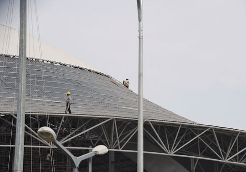 Labourers work at the construction site of a football stadium in Nay Pyi Taw. (AFP)