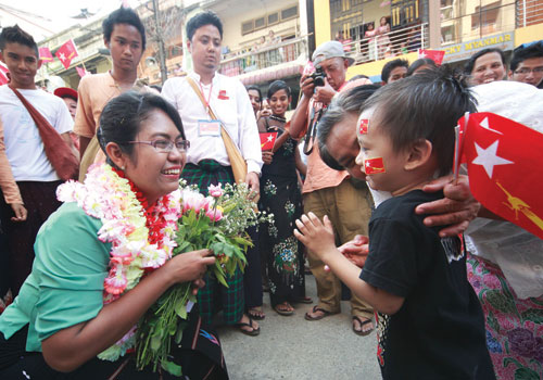 Daw Phyu Phyu Thin campaigns in Mingalar Taung Nyunt township during the lead-up to the April 1, 2012, by-elections. (Yadanar/The Myanmar Times)