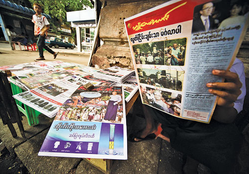A vendor sells journals on the streets of Yangon January 2012. (Yadanar/The Myanmar Times)