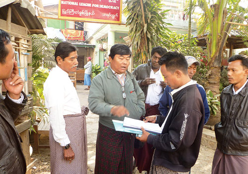 The secretary of an NLD district assembly commission complains about participants' lack of party member cards at the Kha Kway ward assembly in Mandalay's Pyigyitagun township December 22, 2012. (Supplied)