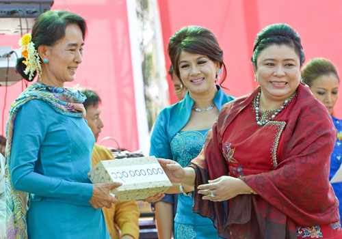 Daw Aung San Suu Kyi accepts a K130 million donation from U Kyaw Win's Shwe Than Lwin company, which owns Shwe FM and Skynet. (Boothee/The Myanmar Times)