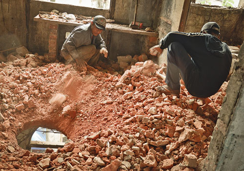 Workers demolish the interior of 233-235 Pansodan Street October 2012. (Boothee/The Myanmar Times)