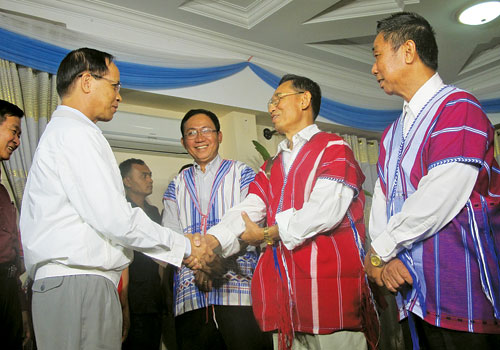 Vice President Dr Sai Mauk Kham (L) is greeted by Karen National Union officials at Royal Kumudra Hotel in Nay Pyi Taw January 5, 2013. (Win Ko Ko Latt/The Myanmar Times)