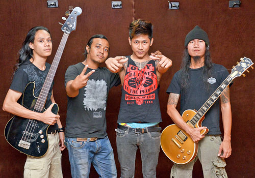 Members of the metal band Nightmare (L to R): bassist Nyi Phyu, drummer Squeeze, vocalist Novem Htoo, and guitarist Aung Myo Linn. (Boothee/The Myanmar Times)