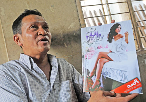 Ko Oo Swe, editor of 'Nyote', at his house in Yangon during an interview in November 2012. (AFP)