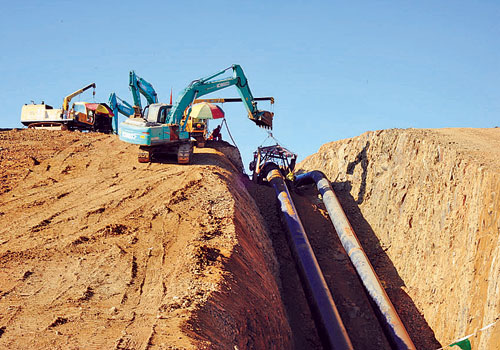 The major shareholders in the Myanmar-China oil and natural gas pipelines have promised to investigate complaints from non-government organisations over land acquisitions, environmental degradation and other issues related to the construction of the pipelines. (Ko Taik/The Myanmar Times)