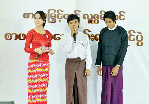 A contestant (C) answers questions from a panel of judges about Daw Ma Ma Lay's novel 'Thu Lo Lu'. (Zon Pann Pwint/The Myanmar Times)