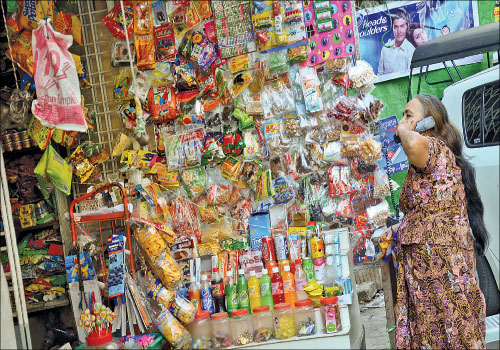 A shop stocked with candy in downtown Yangon January 11, 2013. (Boothee/ The Myanmar Times)