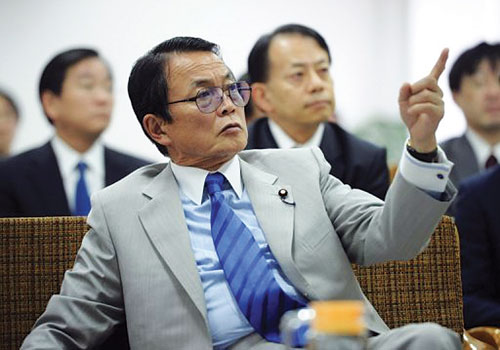 Japanese finance minister Taro Aso during a visit to the Thilawa industrial zone on January 4. (AFP)