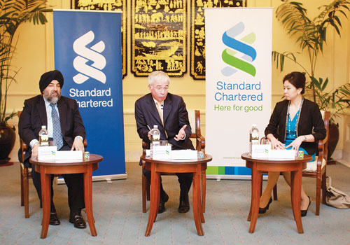 Standard Chartered officials Jaspal Bindra, Peter Sands and Tina Singhsacha, speak during a press conference at Strand Hotel to announce the opening of the bank's representative office in Yangon last week. (Boothee/The Myanmar Times)