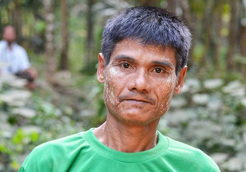 A resident of Kha Lone Htar in a t-shirt that villagers made to show their opposition to a planned dam. (Marcus Rhinelander/The Myanmar Times)