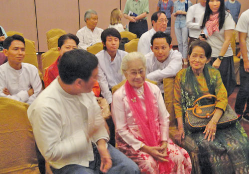 Thant Myint U (L) poses with Daw Hteik Su Paya Gyi (C) at the Yangon Literary Festival.