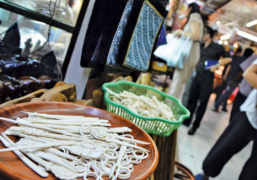 Souvenirs carved from ivory are seen on sale at a shop in Yangon's Bogyoke Market Wednesday, February 2012. (Aung Htay Hlaing/The Myanmar Times)
