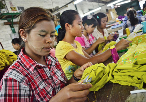 Workers stitch garments at a garment factory in Yangon last week. (Aung Htay Hlaing/The Myanmar Times)