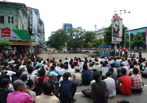 "The crowd of protesters near Sule Pagoda on September 27, 2007, who were described by state media as having ""mobbed the security forces, throwing stones and sticks at them, using catapults and swords"". (Douglas Long/The Myanmar Times)"