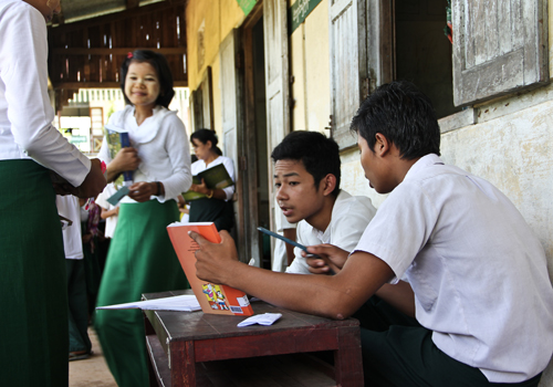 Students delight at the chance to read more with books provided by a mobile library service. Photo: Zarni Phyo