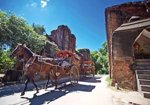 Tourists take a horse cart through a gate in the walls of the old city of Bagan. (Kaung Htet/The Myanmar Times)