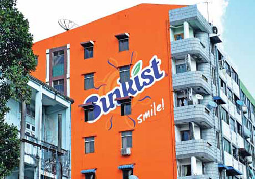This 'Sunkist building' on Bogyoke Aung San Road in Pazundaung township is one of eight in Yangon, Myanmar Distribution Group says. (Aung Htay Hlaing/The Myanmar Times)