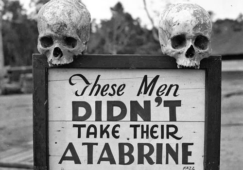 A macabre sign advertises Atabrine brand anti-malaria medicine at the 363rd Station Hospital in Guinea during World War II. Photo: Otis Historical Archives