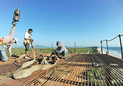 Construction labourers works on an elevated platform at a deepsea port project in Mayingyi, part of the Dawei Special Economic Zone development last year. Photo: AFP