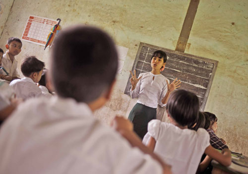 A primary school teacher leads a class in a rural school. (Kaung Htet/The Myanmar Times)