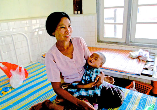 Ma Khine Mo Shwe with her son, Tu Cha Aung, after surgery. Photo: F MacGregor