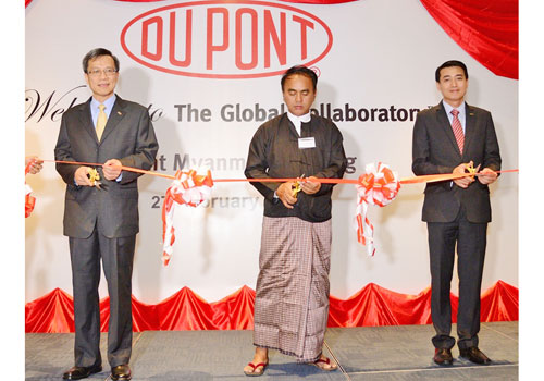 Hsing Ho, left, director of Ministry of Agriculture and Irrigation Thant Lwin Oo, center, and Sittideth Sriprateth cut a ribbon at the opening of DuPont Myanmar last month. Photo: Supplied
