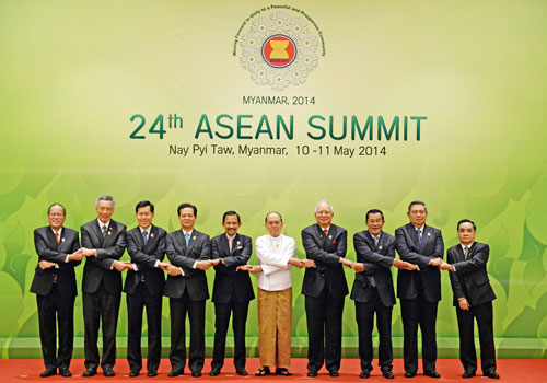 Regional leaders including President U Thein Sein (centre) join hands as they pose for a photograph at the start of the 24th ASEAN Summit in Nay Pyi Taw on May 11. Photo: AFP
